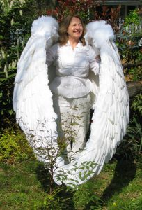 the 16' wings are wrapped around Debra at rest